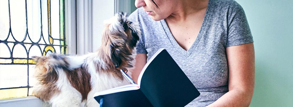 owner reading to dog