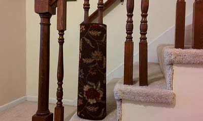Staircase Spindle Cat Scratching Rail Flowered Area Rug Wred Around